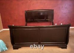 Cal King Sleigh Bed Frame. Heavy solid wood. Rc Willey. Las Vegas pick up only