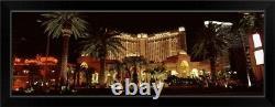 Hotel lit up at night Monte Carlo Resort Black Framed Wall Art Print, Las Vegas